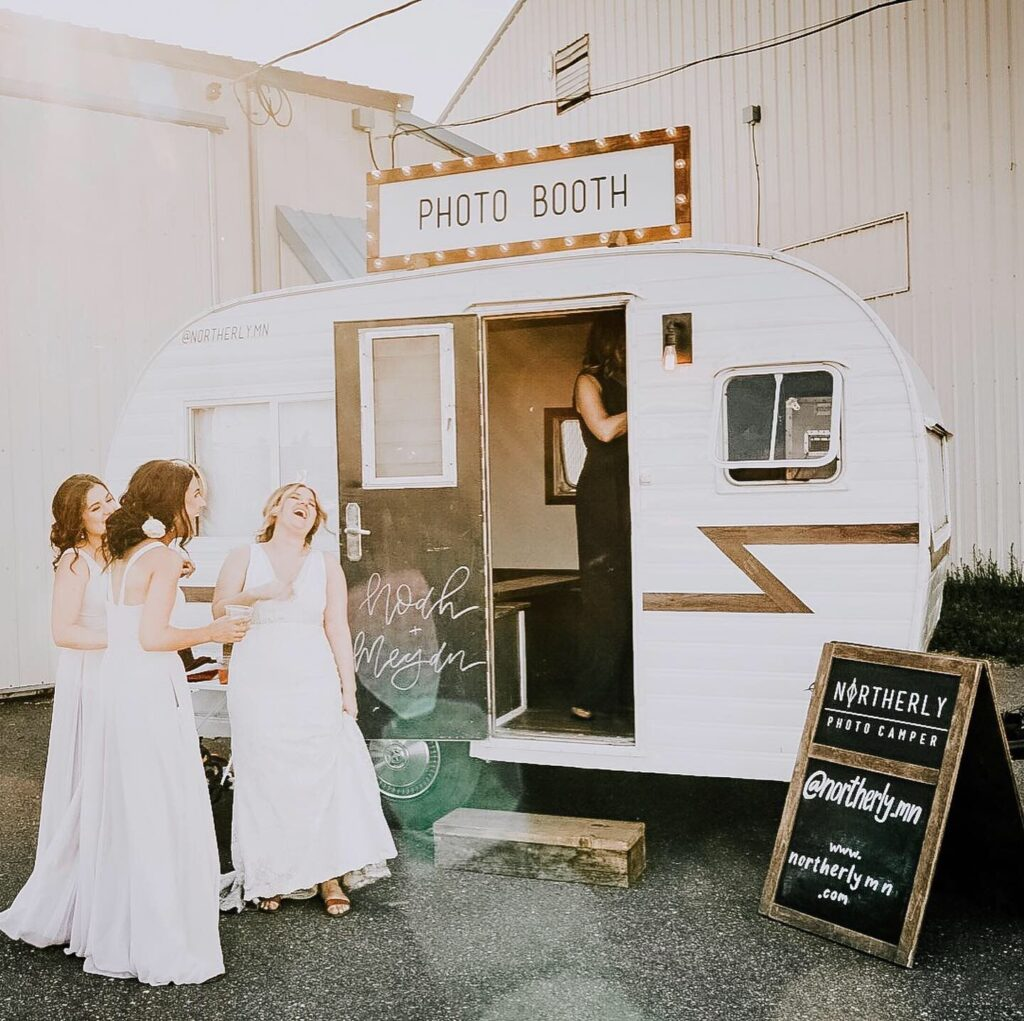 Bridesmaids with camper photo booth