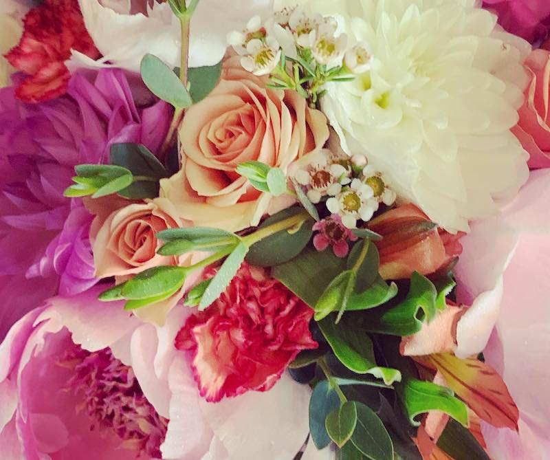 Pink, white, and red floral bouquet for wedding by Pocket Full of Posies