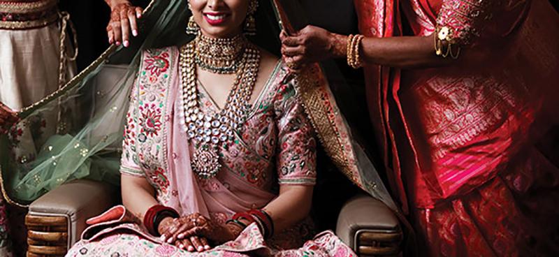 Hindu Bride with ghoonghat at cultural wedding