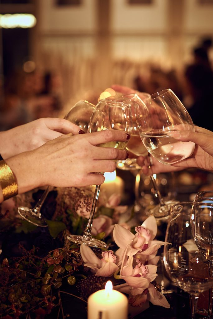 Guests clinking glasses to cheers