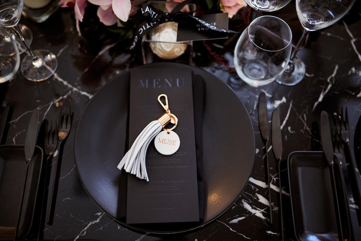 All black wedding tabletop plates, menu, and flatware