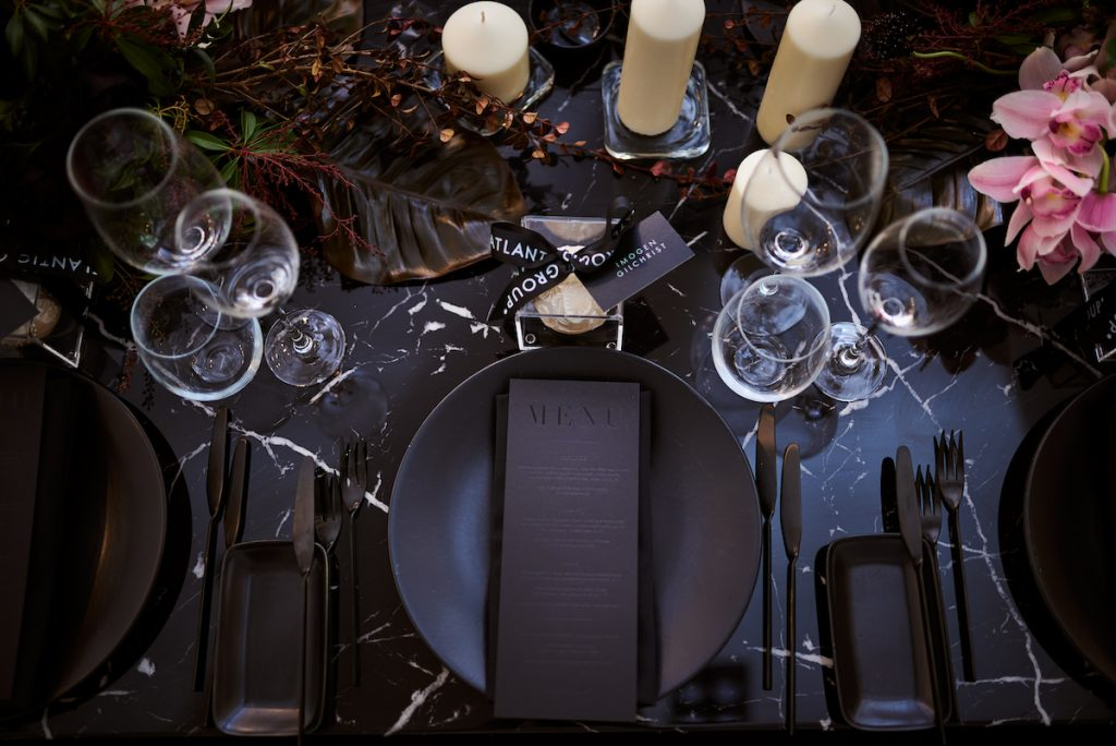 Matte black plate with black wedding menu
