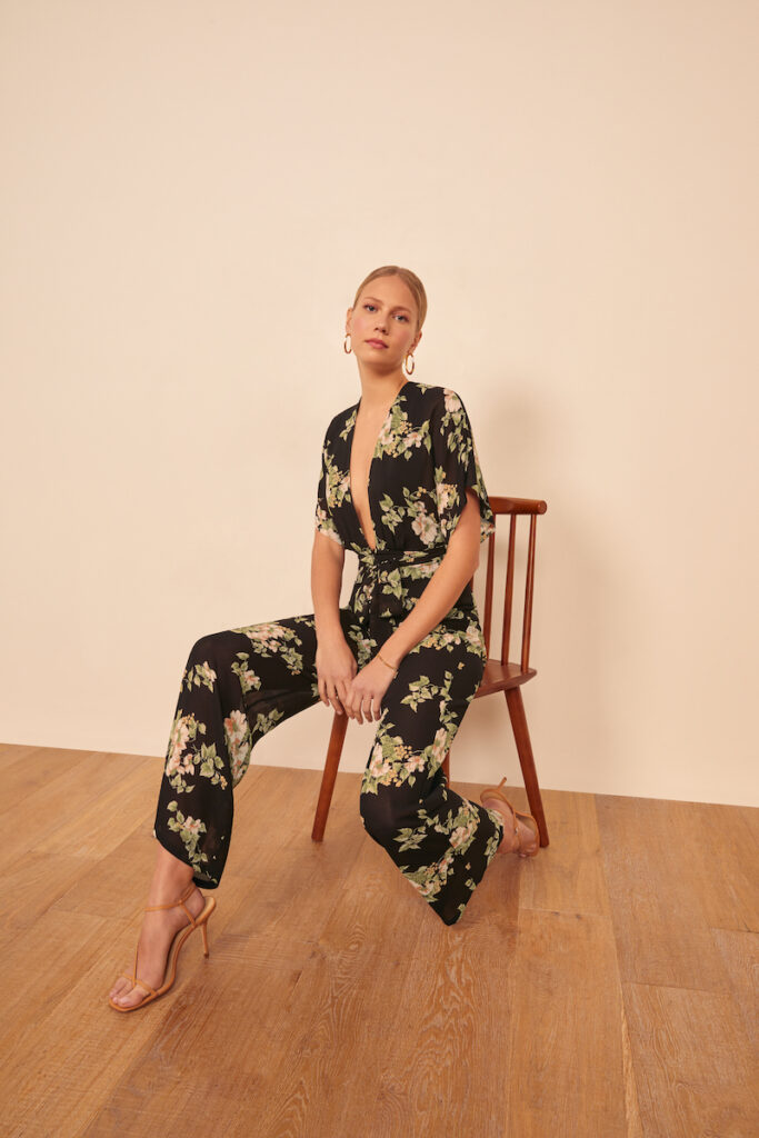 Patterned black jumpsuit for fall wedding by Reformation