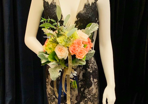 Black bridal gown with peach and pink wedding floral bouquet
