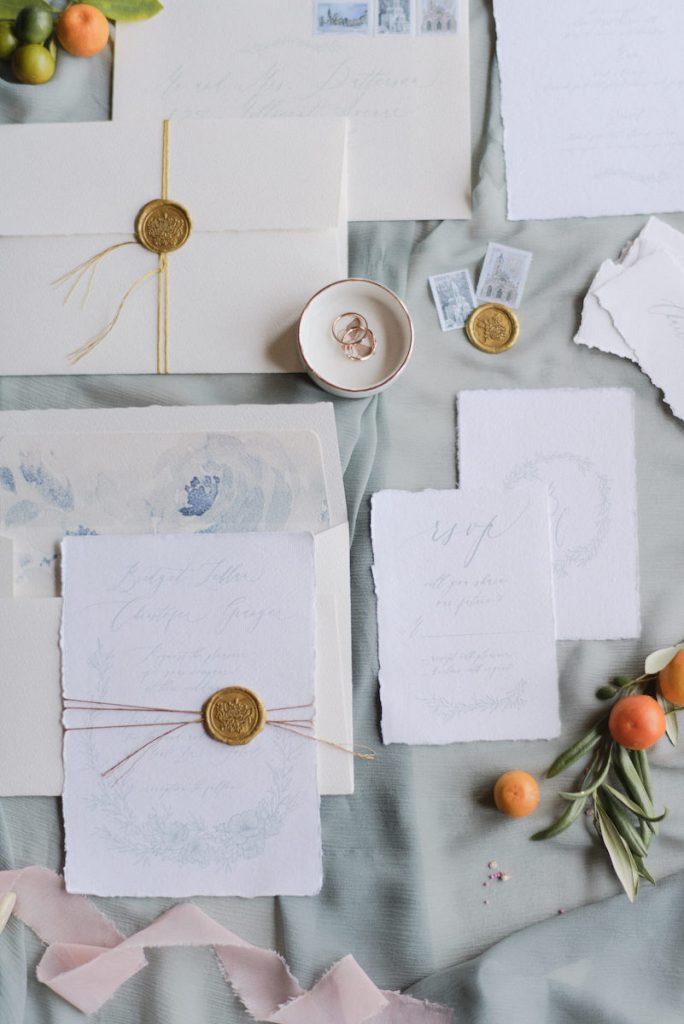 Torn-edge wedding invitations