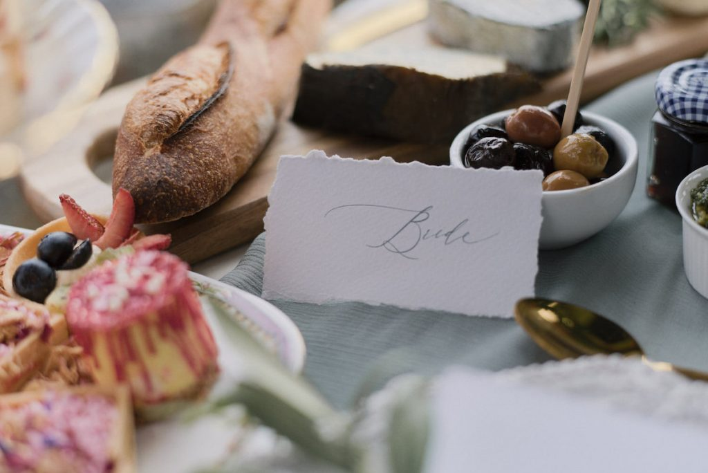 """Torn edge place setting card that says """"Bride"""""""