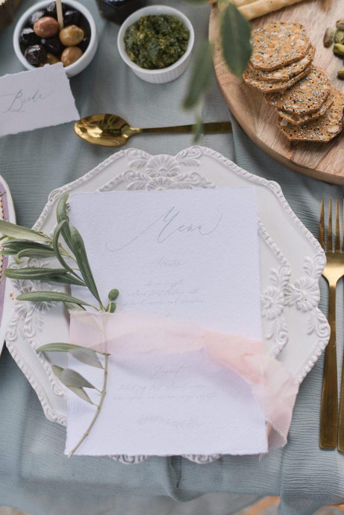 Torn edge wedding menu with blue ink