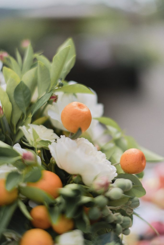 Wedding centerpiece with citrus and white flowers