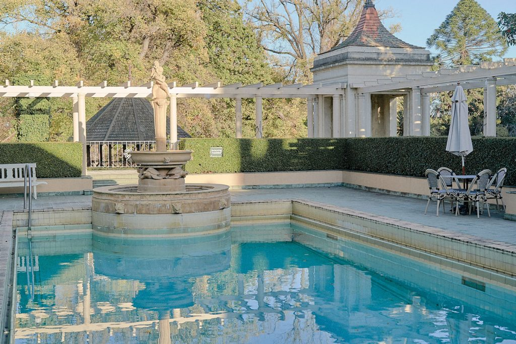 Victorian statue and pool