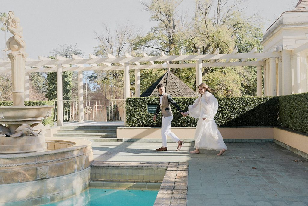 Bride and groom outside at poolside wedding