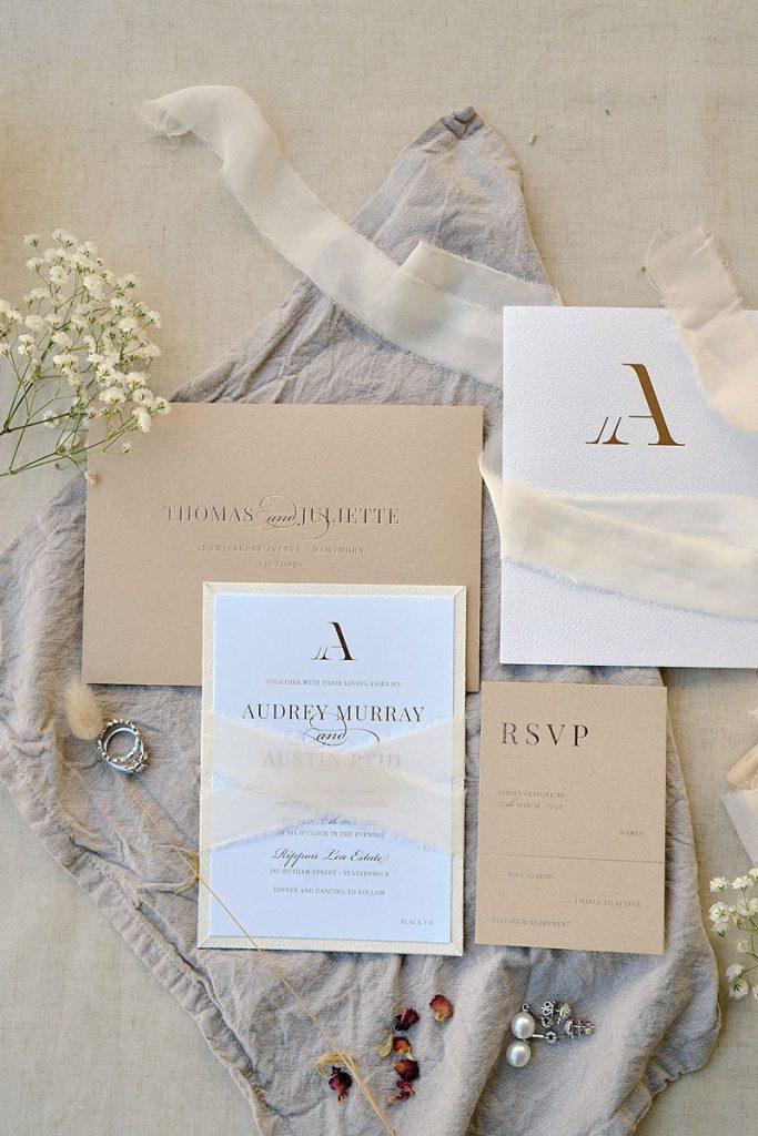 Beige and white embossed wedding invitaiton