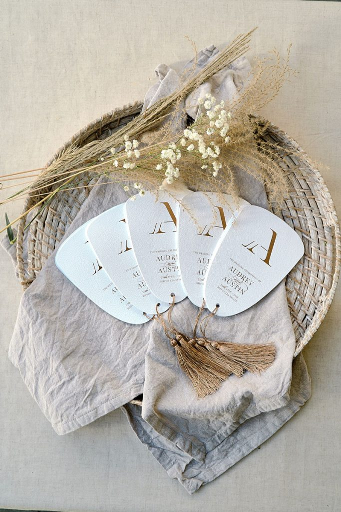 Fans for wedding guests with monogram motif