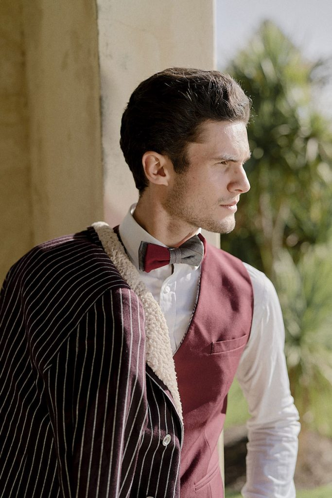 Groom in maroon vest and pinstriped coat