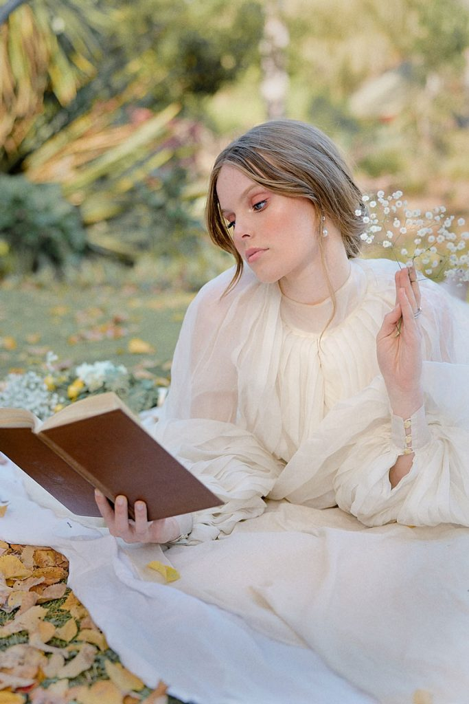 Bride reads book in a boho flowy gown