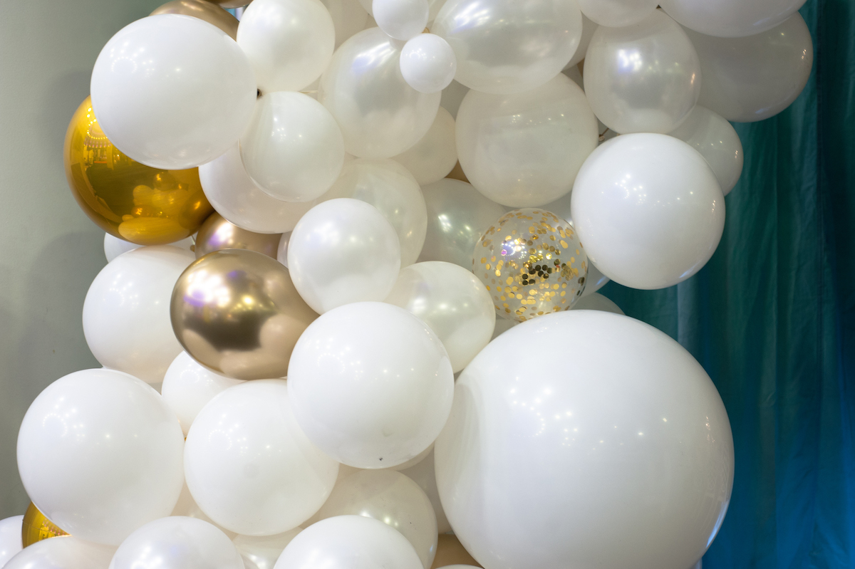 White and gold wedding balloon arch