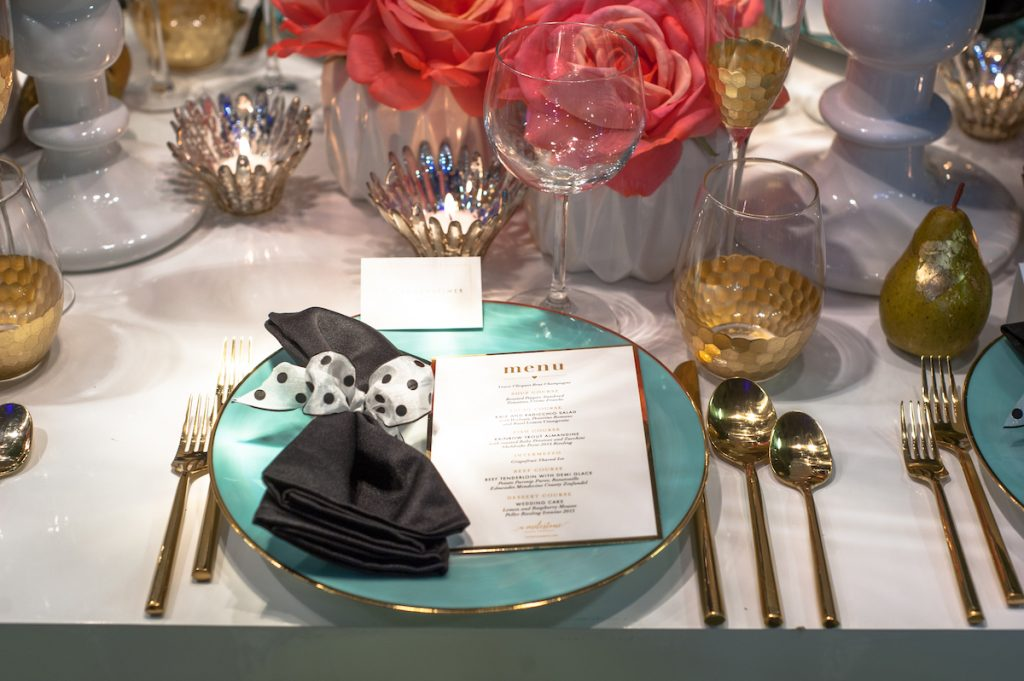 Blue wedding plate with gold flatware