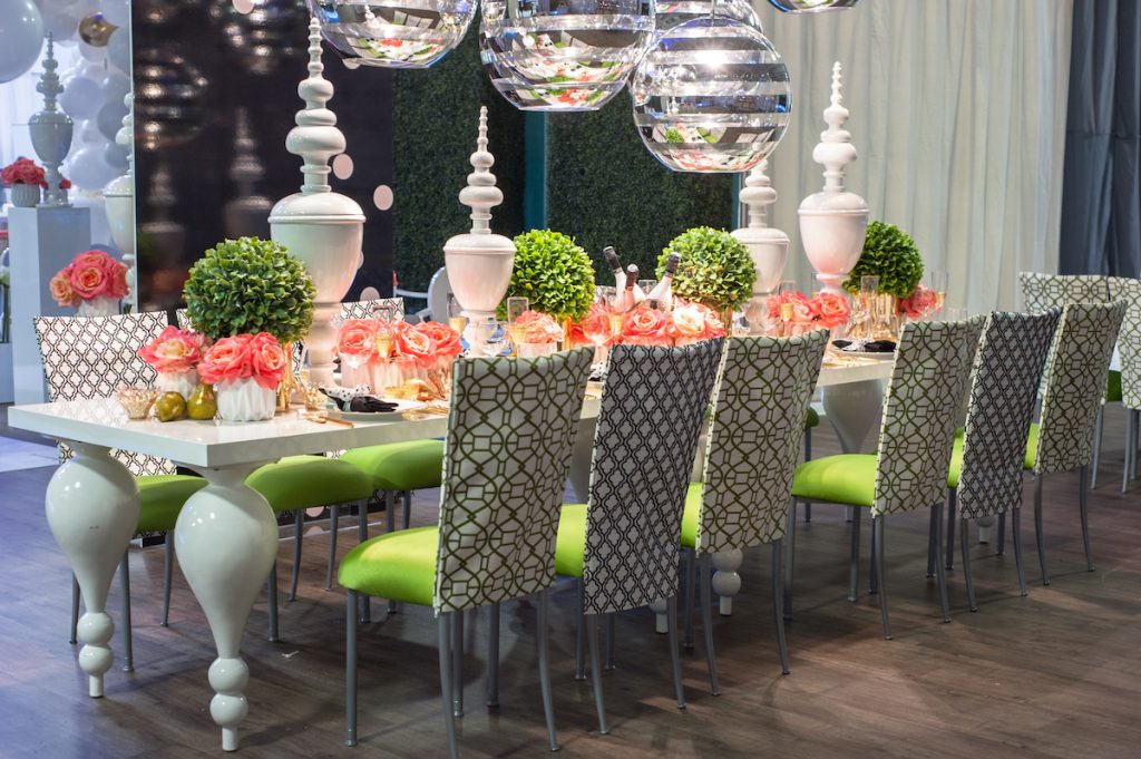 Wedding table with bright pink and greenery