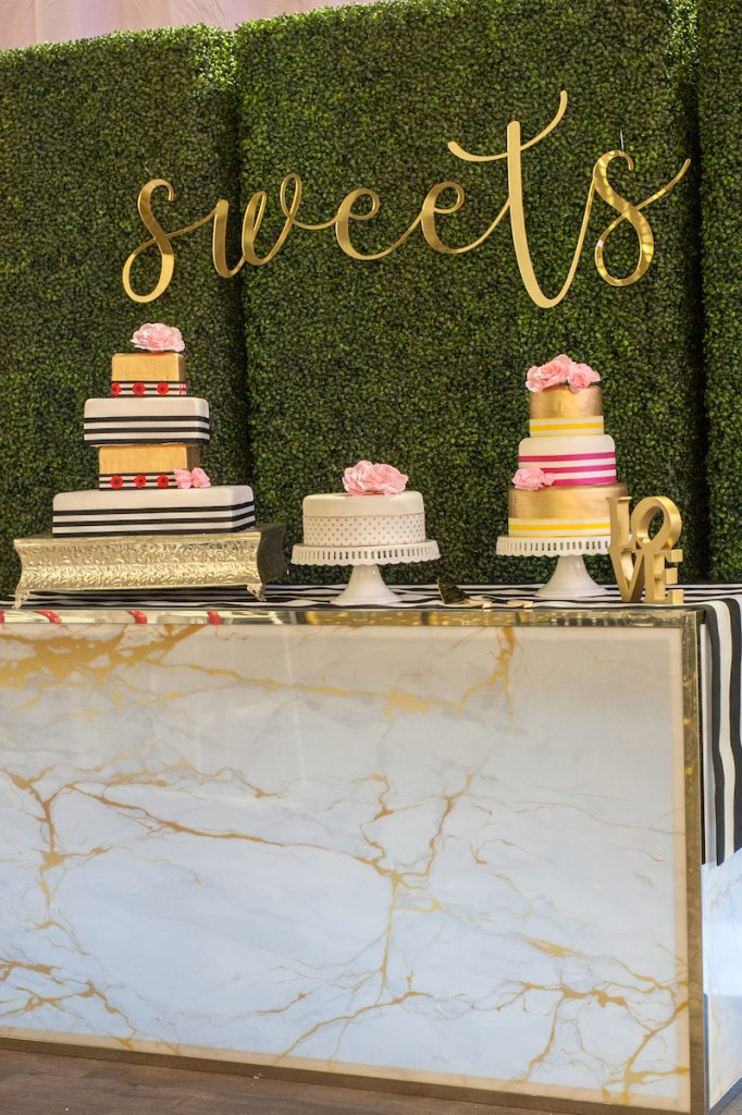 Three wedding cakes with stripes and flowers