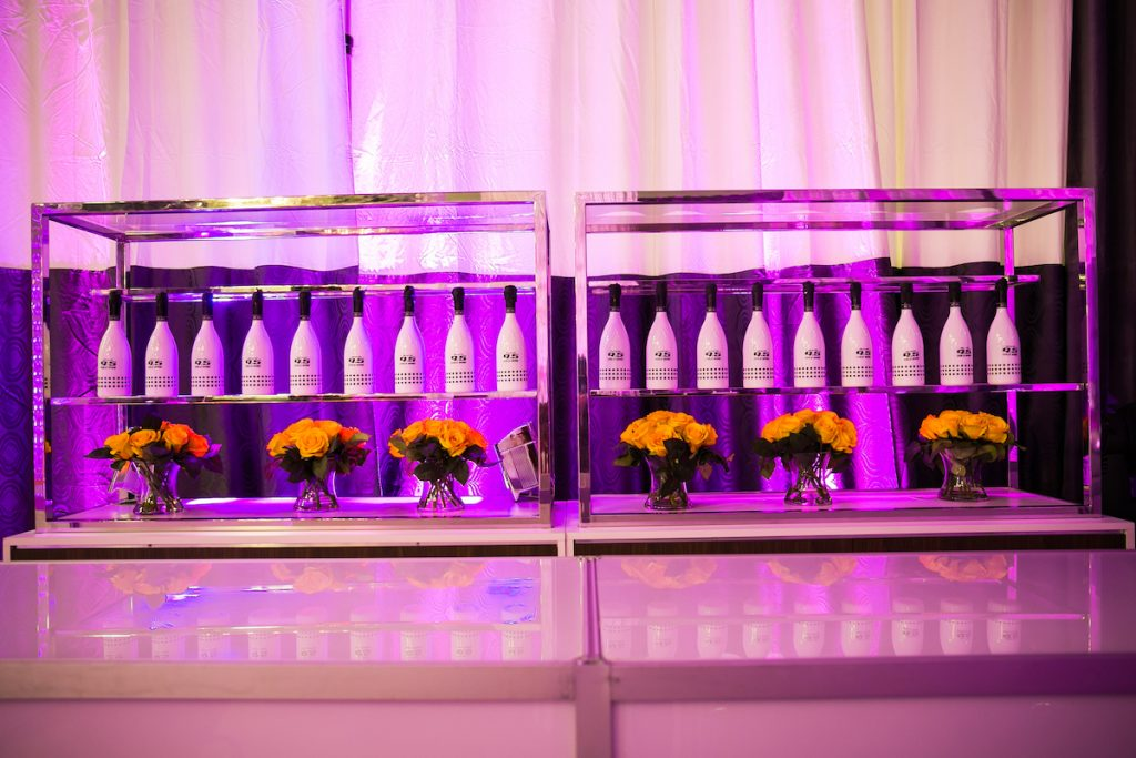 Retro wedding bar with graphic black and white champagne bottles