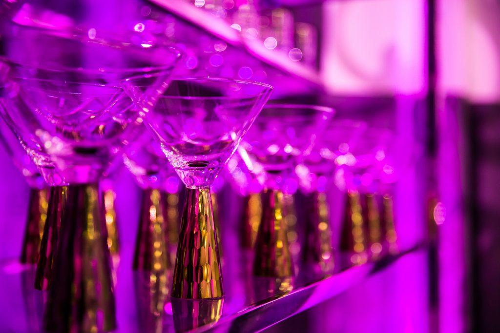 Thick gold-stemmed martini glasses