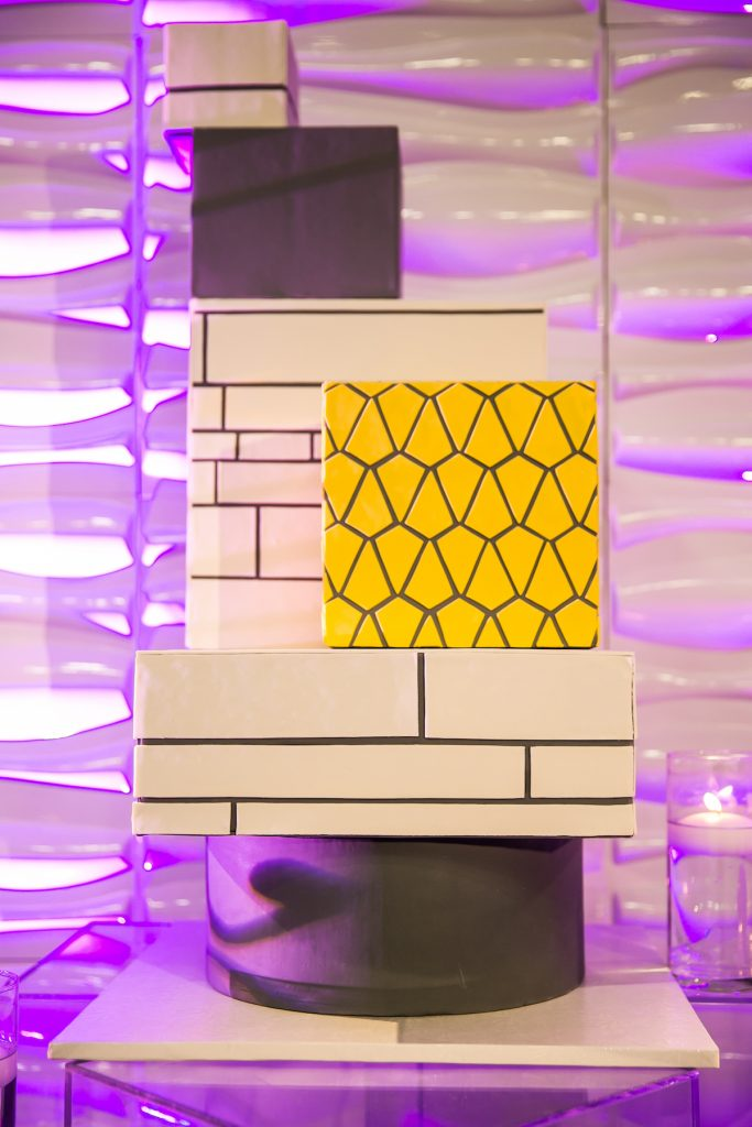 Yellow and gray square tiered cake