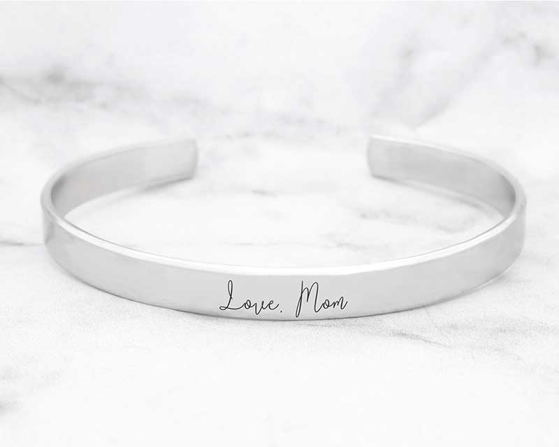 "Silver cuff bracelet with ""Love, Mom"" engraved by Sincerely Silver"