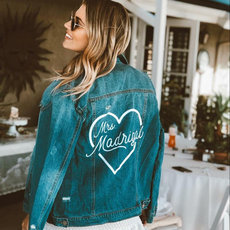 "Bride in custom ""Mrs"" jean jacket by Shades of Pink boutique"
