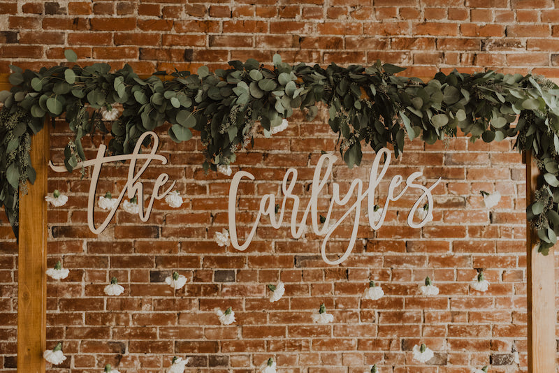 Wedding photo booth backdrop with greenery