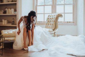 Bride puts on Louboutin wedding shoes