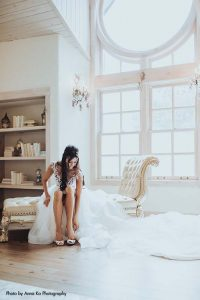 Bride in gown with detachable skirt by Berta