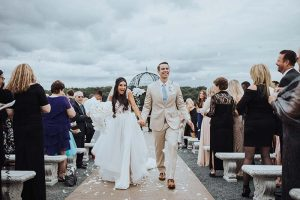 Bride and groom walk down aisle after ceremony