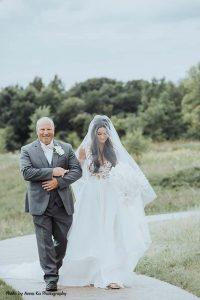 Bride walks down aisle in couture Berta wedding dress
