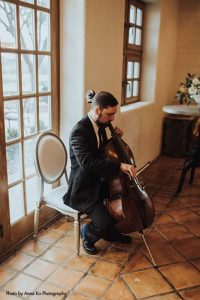 Cello plays at Bavaria Downs for wedding
