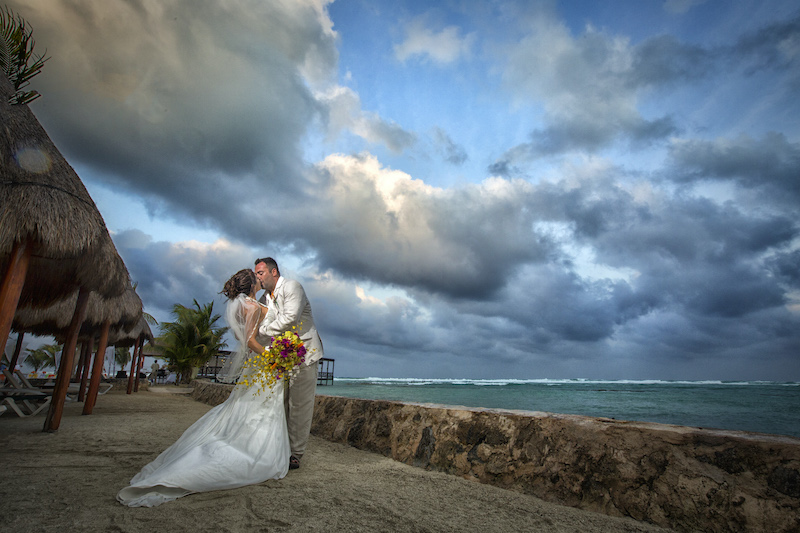 Bride and groom marry on beach for destination wedding