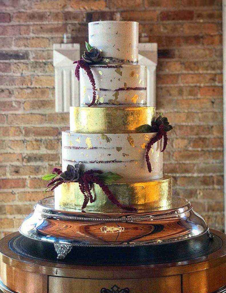 Modern gold and burgundy wedding cake by Flourish Cake Design