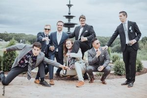 Groomsmen pose for funny picture at wedding