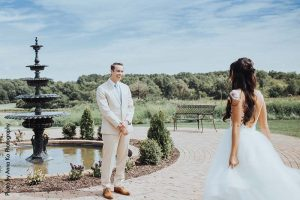 Groom in tan suit sees bride in couture wedding dress for first time