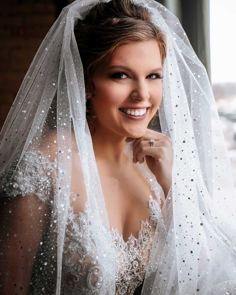 Photo of Minnesota bride with sparkly veil by Dempag Photography