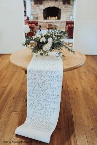 Quote table runner at elegant Minnesota wedding