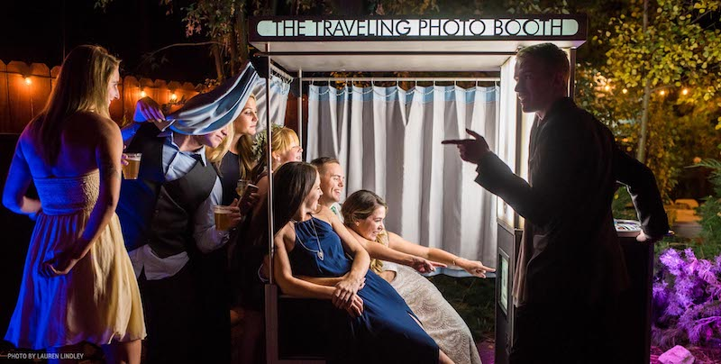 Wedding party takes photos in photo booth