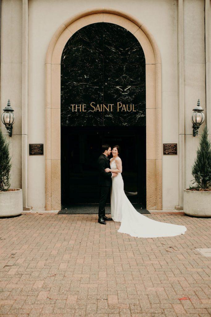 Bride and groom stand outside Minnesota luxury wedding venue