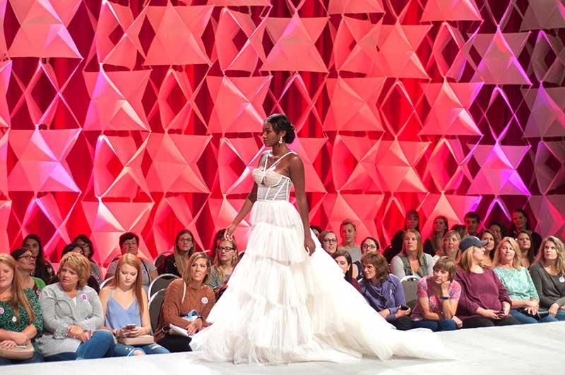 Model walks in bridal fashion show