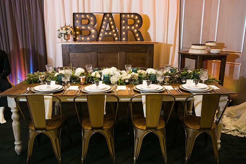 Farm-to-table rustic wedding theme head table set up at Twin Cities Bridal Show Inspiration Station