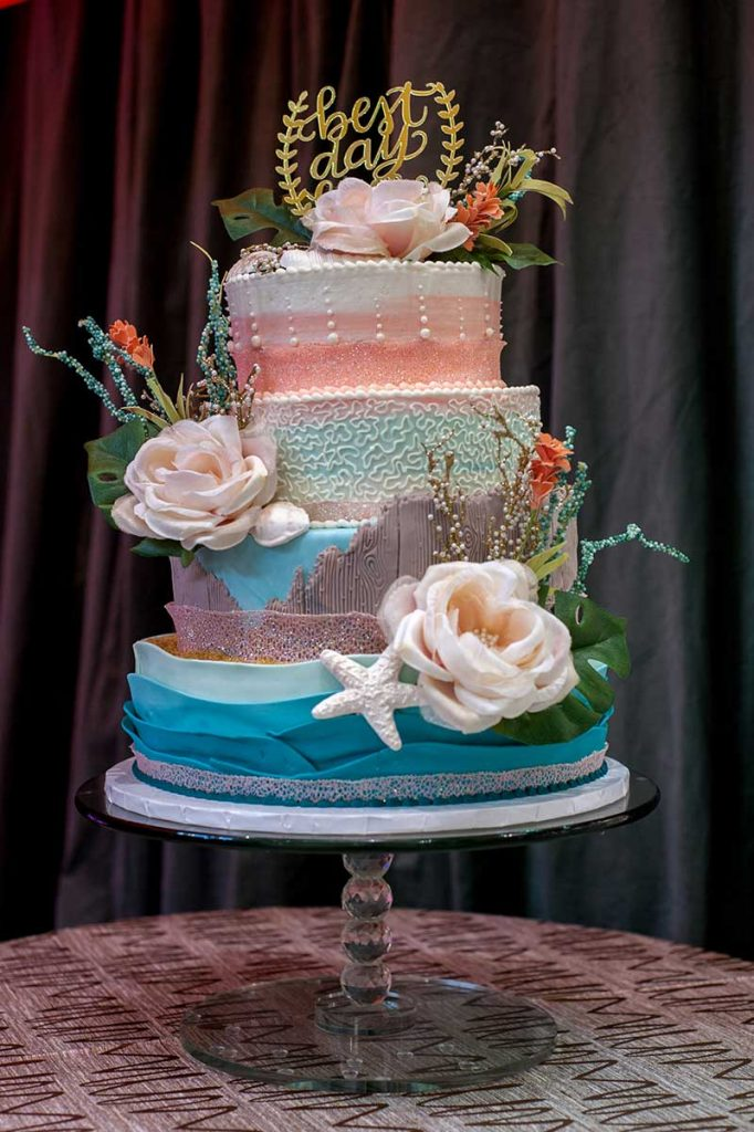 Blue and pink wedding cake at the Twin Cities Bridal Show Inspiration Station