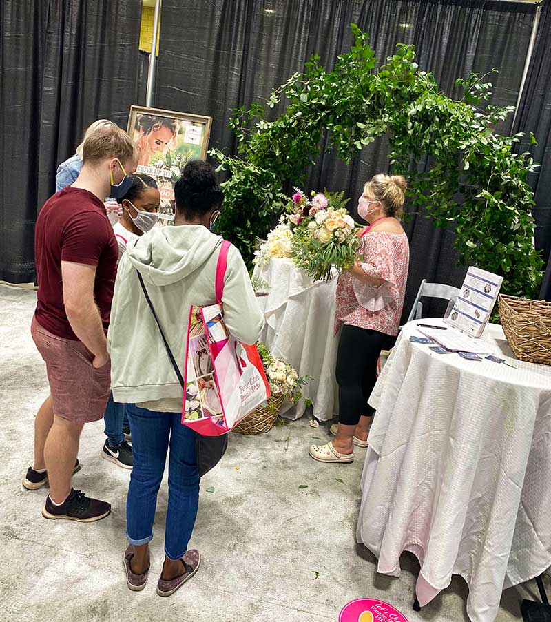 Couple meets with wedding vendor at 2020 Twin Cities Bridal Show