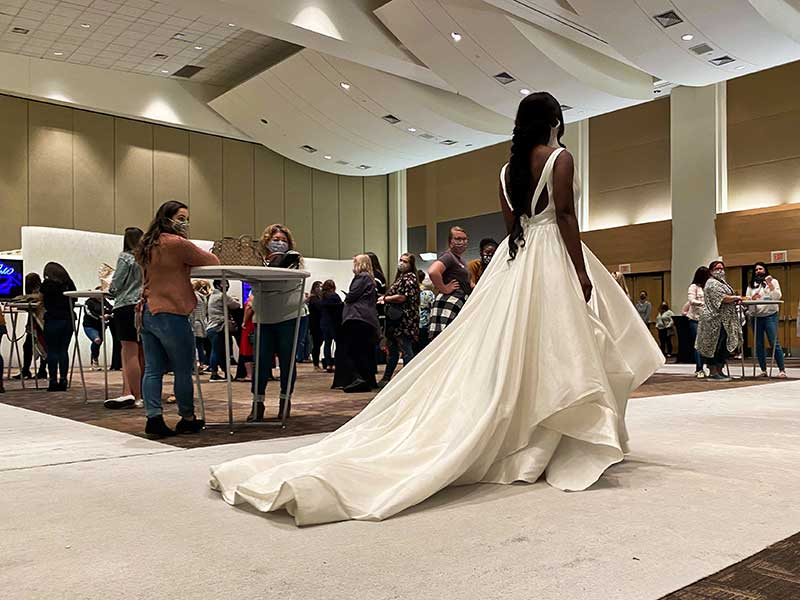 Model wears modern and sleek ballgown at the 2020 Twin Cities Bridal Show