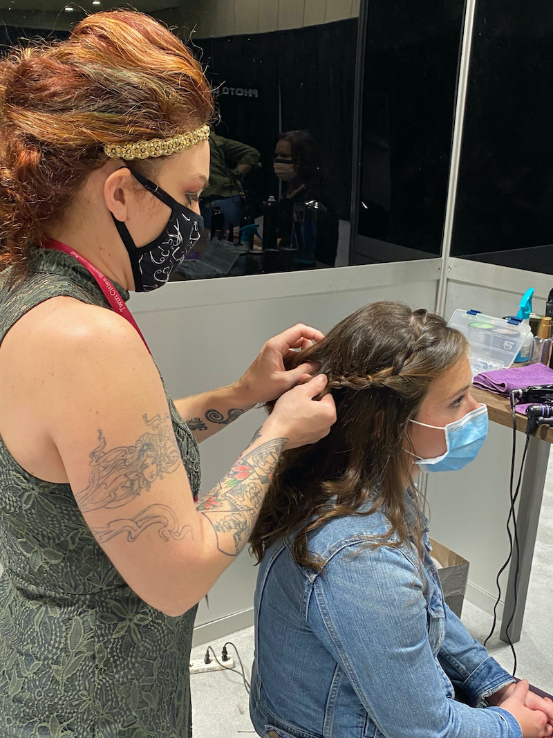 Bride gets hair done at the 2020 Twin Cities Bridal Show