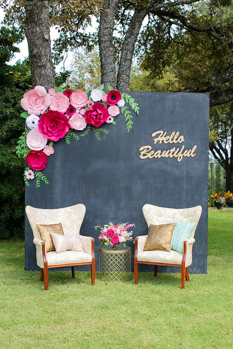 Creative photo backdrop with black wall and flowers