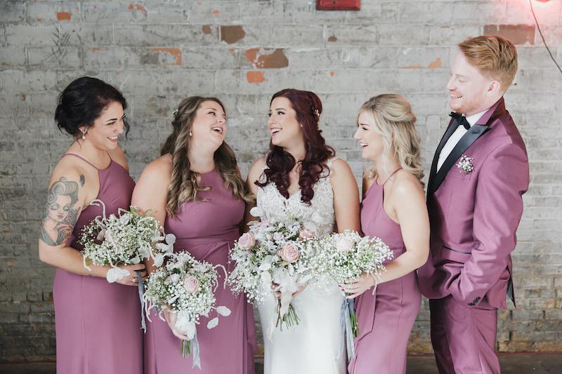 Bridal party with bridesman in mauve suit