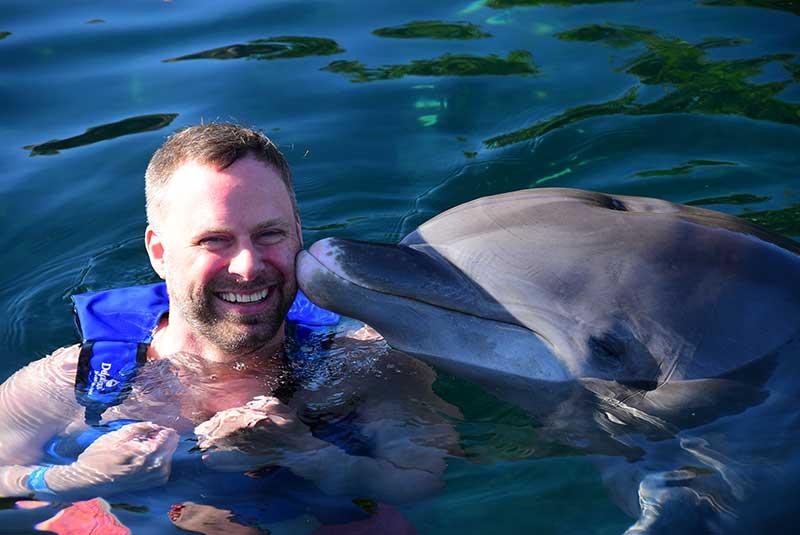 Man takes a swim with dolphin